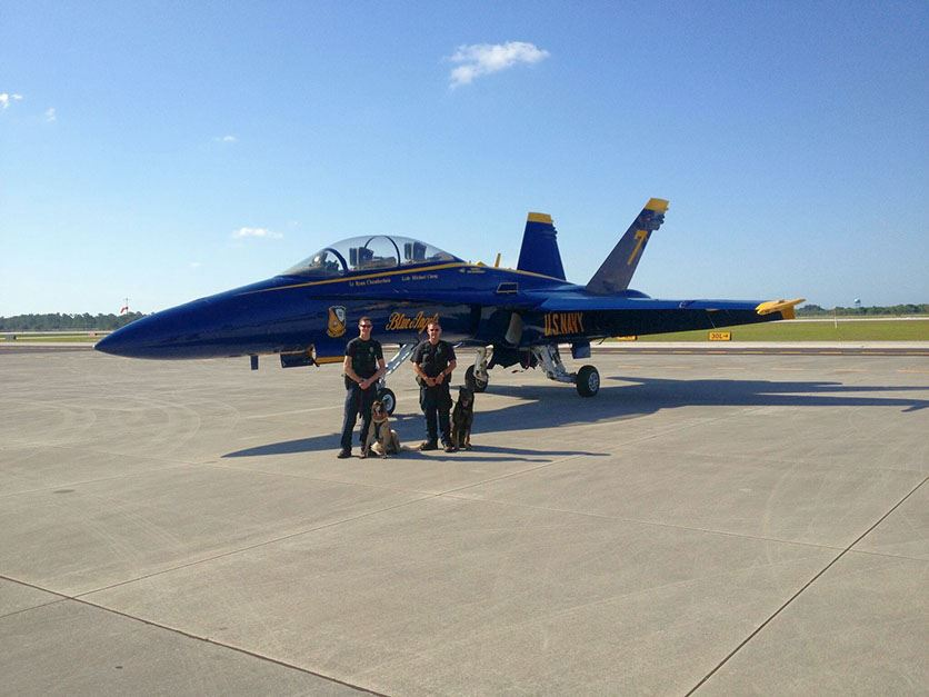 K-9 Officers with Navy Jet